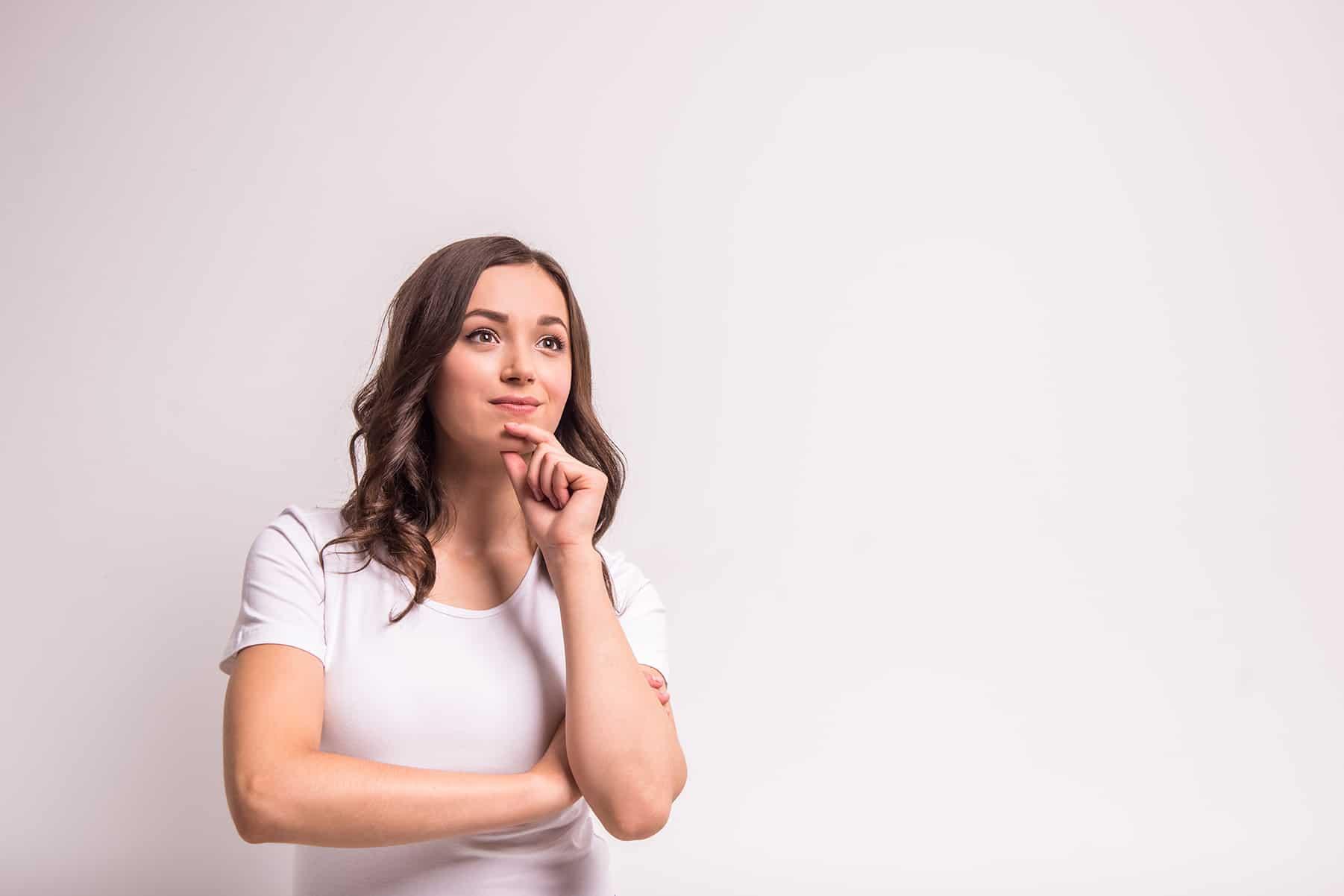 Woman ponders a career in holistic health coaching